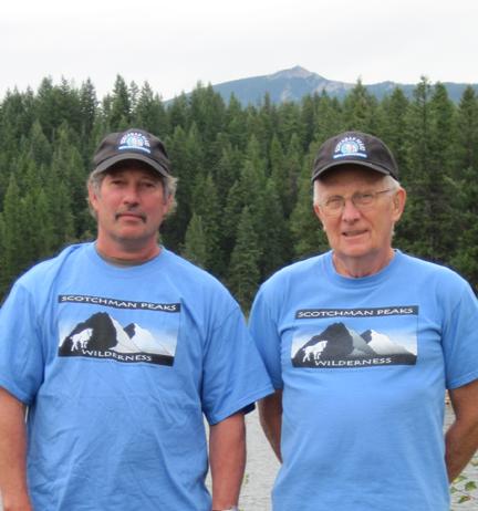 3,000th Friend Rick Dieterich (L) and FSPW volunteer Ernie Scherzer show off their new Scotchman Peaks hats with Star Peak in the background