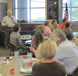 FSPW exec Phil Hough keeps his audience focused on the PowerPoint during his June 9 Sandpoint Chamber presentation.