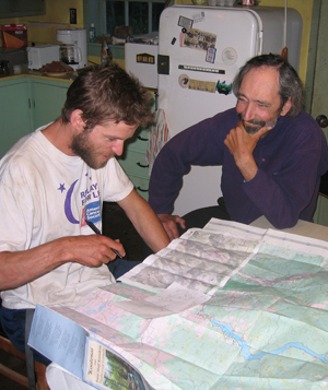 Daniele Puccinelli (L) entertains Walkin' Jim with tales of his hikes through the Soctchman Peaks.