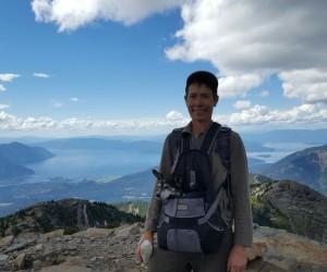 Julie Kallemeyn stands atop of Scotchman Peak with her dog Dex.