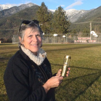 Mindy shows off her MWA Brass Lantern Award in the school yard at Noxon, where she taught for 23 years.