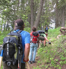 Joel Sather of the FS leads the way up Trail #998 as FSPW volunteer Jake Ostman removes a chunk of blowdown from the trail. (Photo courtesy Jacob Styer)